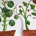 Décors de légumes peints sur cartons pouvant jalonner les bas de murs de la salle d'exposition pour recréer une ambiance jardin.