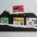 Porte-album des livres concernant Akiko - Quatre emplacements pour chaque album sur le mont Fuji